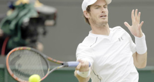 Andy Murray of Britain returns a ball to Robin Haase of the Netherlands, during their singles match at the All England Lawn Tennis Championships in Wimbledon, London, Thursday July 2, 2015. (AP Photo/Alastair Grant)