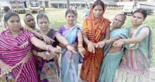 Begusarai: Voters show their inked fingers after casting votes for Bihar assembly elections in Begusarai on Monday. PTI Photo (PTI10_12_2015_000059B)