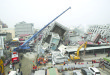A crane helps lift heavy pieces of concrete during the massive rescue effort currently underway in Taiwan .