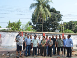 Members of Hill View Colony offer a pose after the inauguration of new garbage disposal structure, seen to their right.