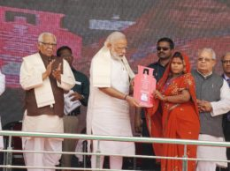 """Ballia: Prime Minister Narendra Modi presents cooking gas connection to a woman of Below Poverty Line (BPL) family during a  launch of """"Pradhan Mantri Ujjwala Yojana"""" in  Ballia on Sunday. PTI Photo(PTI5_1_2016_000055B)"""