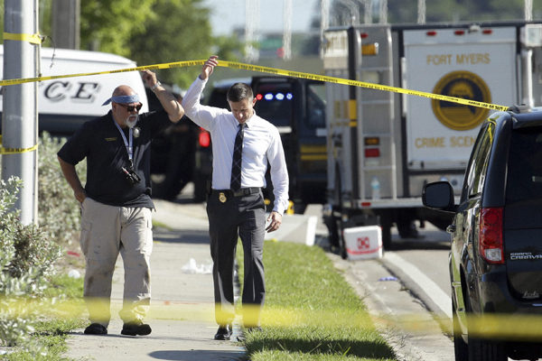 Officials investigate the scene of a deadly shooting outside of the Club Blu nightclub, Monday, July 25, 2016, in Fort Myers, Fla. Gunfire erupted at the nightclub hosting a swimsuit-themed party for teens.  (AP Photo/Lynne Sladky)(AP7_25_2016_000275B)