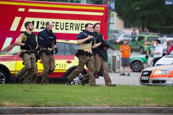 Munich : Policemen arrive at a shopping centre in which a shooting was reported in Munich, southern Germany, Friday, July 22, 2016. Situation after a shooting in the Olympia shopping centre in Munich is unclear.  AP/PTI(AP7_22_2016_000305B)