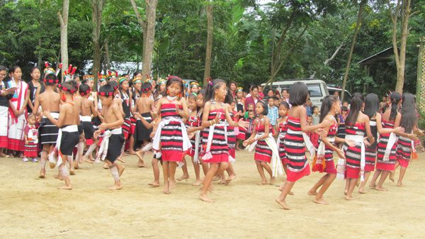Children of Mhaikam village dance during the day's occasion.
