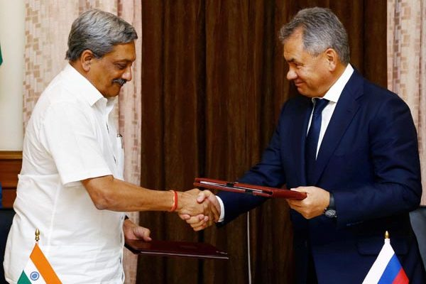 Defence Minister Manohar Parrikar and his Russian counterpart Sergey Shoigu exchange protocol document after the 16th meeting of the India-Russia Intergovernmental Commission on Military-Technical Cooperation in South Block, New Delhi on Wednesday.