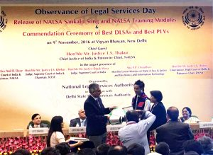 B Yemlong Chaba, Para Legal Voulunteer (PLV) and along with the Member Secretary of Nagaland State Legal Services Authority (NSLSA) receiving certificates and mementoes from Chief Justice of India.