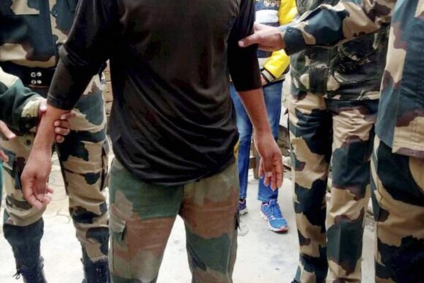 Attari: Indian soldier Chandu Babulal Chauhan being received by Border Security Force personnel after he was handed over to them by Pakistan Rangers at Attari border on Saturday. Chauhan had inadvertently corssed the Line of Control on September 29th, 2016 from Jammu and Kashmir. PTI Photo (PTI1_21_2017_000185B)
