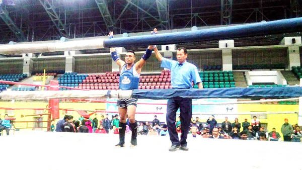 Hemavi Ayemi after defeating his opponent at the 5th Federation Cup Muay Thai Championship at Tepesia Sports Complex in Sonapur, Assam.