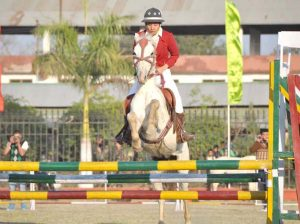 A young lady rider participating in the show jumping competition in Imphal on Friday.