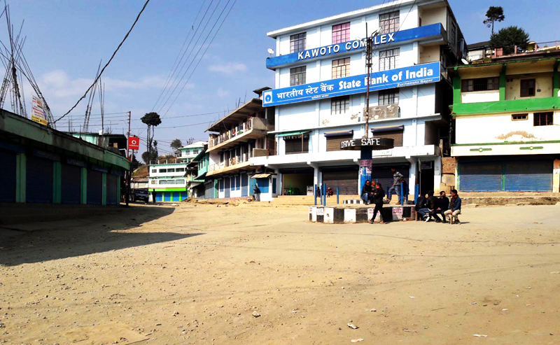 Volunteers guard an intersection in deserted Zunheboto town on February 15.
