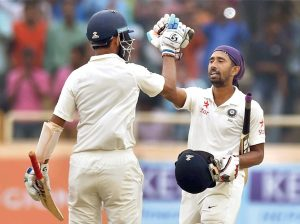 Ranchi: Indian batsman Cheteswar Pujara greets his teammate Wriddhiman Saha after he complete his century during 4th days play of 3rd test match against Australia in Ranchi on Sunday. PTI Photo by Swapan Mahapatra(PTI3_19_2017_000101B)