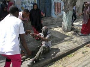 Mogadishu : A wounded man reaches out to rescuers after a car bomb attack in Mogadishu, Somalia Monday, March 13, 2017. A suicide car bomber detonated near the Weheliye hotel in the capital Monday morning, killing a number of people on the busy Maka Almukarramah road, police said. AP/PTI(AP3_13_2017_000043B)