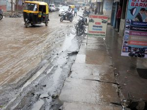 The pavements of Kalibari Road look like a mud stream after Monday's light shower.